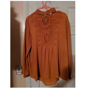 Long-sleeved blouse with decorative high collar